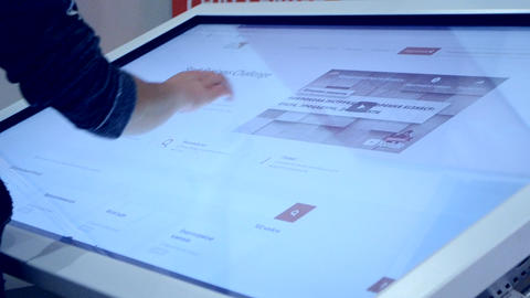 Girl moves drawing with her fingers on the big touch screen ビデオ