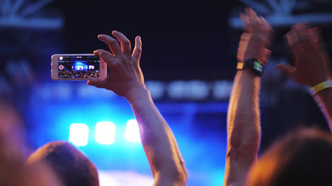 A slow motion of two men in the crowd at an open air concert Live Action