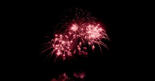 Celebration firework exploding and glow over dark background with dark and grain Live Action