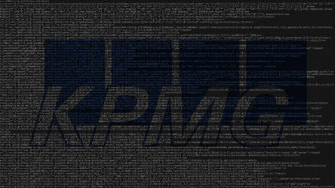 KPMG logo made of source code on computer screen. Editorial loopable animation ビデオ