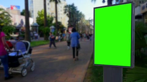 Billboard green screen on the background of city street Footage
