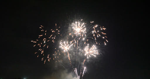 Celebration firework exploding and glow over dark background with dark and grain Footage