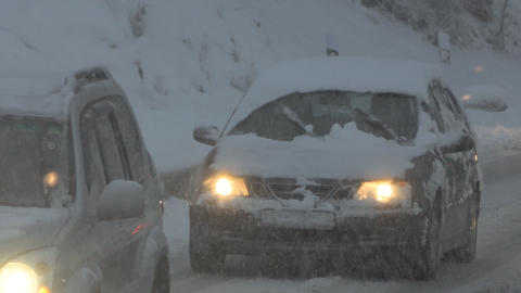 The snowfall on the road. Cars moving with a lot of snow on it Footage