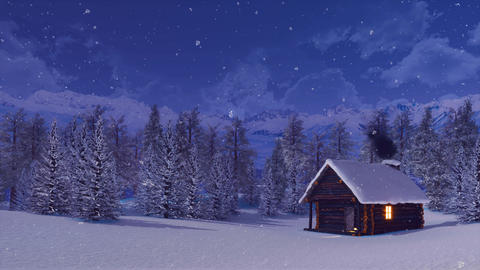 Snow covered mountain hut at snowfall winter night GIF