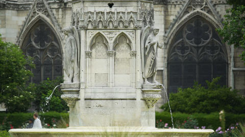 Fountain of the Virgin and Notre Dame de Paris, famous attractions, France Footage