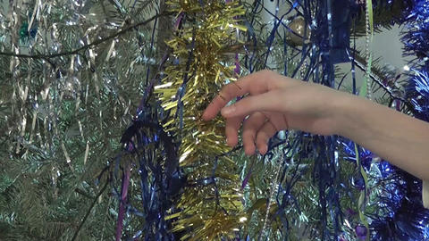 Girl touch Christmas decoration, only hands GIF