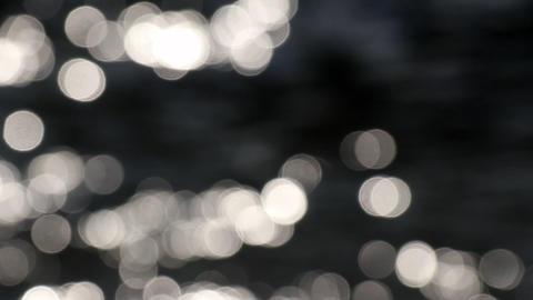 Abstract nature. Bokeh sun glare glistening on water surface ビデオ