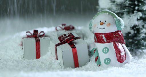 Snowman and christmas gifts under snow Footage