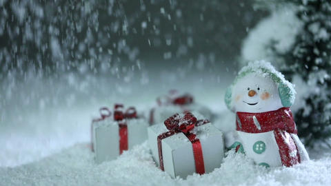 Snowman and christmas gifts under snow ビデオ