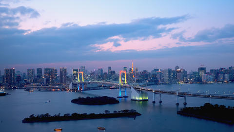 TimeLapse - Daytime to night scenery in Tokyo and Tokyo bay - Pan right to left Footage