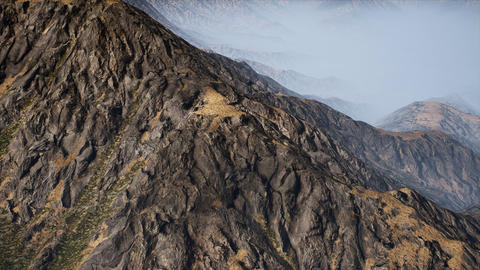 4K Aerial View of Eroded Rocky Mountains in Fog 3D Animation Animation