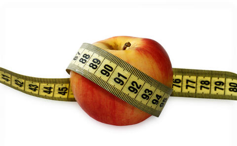 Apple with measuring tape Photo