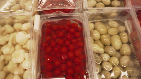 Pickled vegetables: garlic, cucumbers, tomatoes on the market Footage