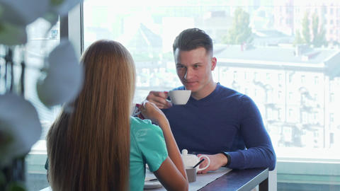 Handsome cheerful man having date with his girlfriend, enjoying breakfast Footage