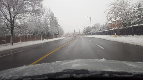 Driving Through Snowy Suburb in North America Footage