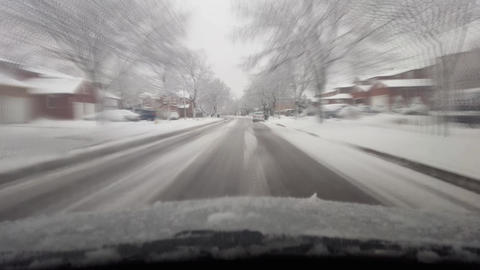 Driving Through Snowy Surburb in North America With Motion Blur Effect Footage