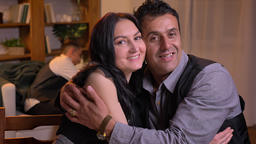 Portrait of arabic spouses hugging each other and smiling into camera sitting on Footage