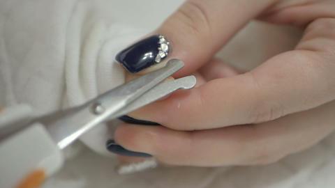 Mother cutting newborn baby's nails 영상물