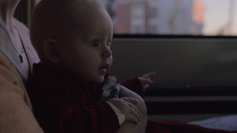 Mum with baby daughter on car journey Footage