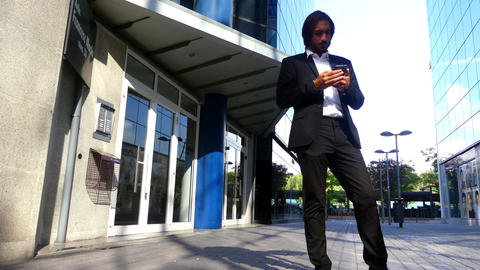 Businessman Checks His Smartphone While Waiting Footage