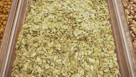 Raw pumpkin seeds background. Food texture. 4k. Vegan food concept Footage