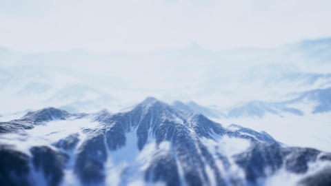 4K Aerial View of Hazy Frozen Mountains Cinematic Tilt Shift 3D Animation Animation