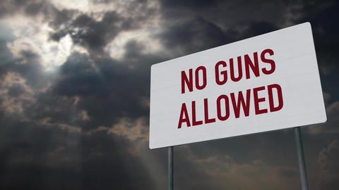 4K No Guns Allowed Warning Sign under Clouds Timelapse Animation