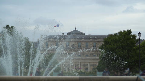 View of Luxembourg Palace in Paris through fountain, sightseeing tour, France Live Action