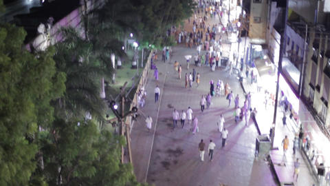 Peoples walking entrance on temple at night, Pedestrian street with hindu temple GIF