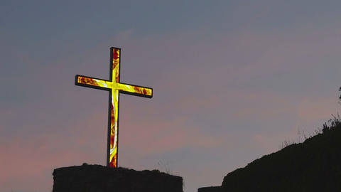 Illuminated cross against dusk sky, religion and spirituality, faith in god Footage