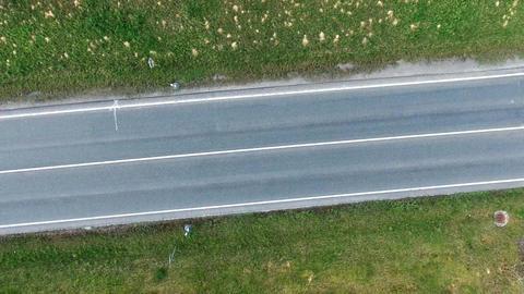 Car on asphalt road in summer Footage