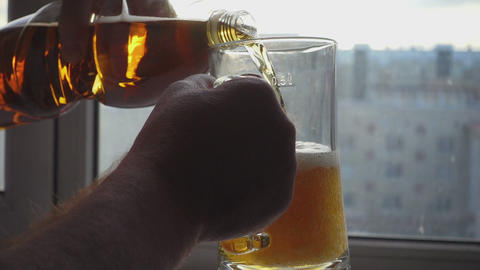 Pouring beer into mug Footage