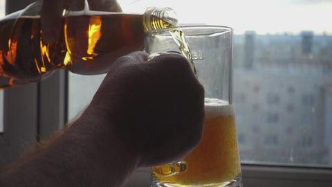 Pouring beer into mug Footage