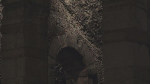 Spooky arched doorway, stone wall of mysterious building illuminated at night Footage