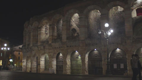 Verona Arena Roman amphitheater in Italy at night, ancient architecture, slow-mo Footage