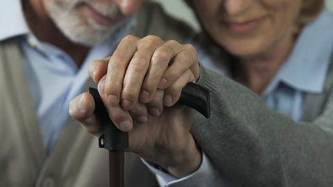 Old couple still holding hands, going through joy and troubles in life together Footage