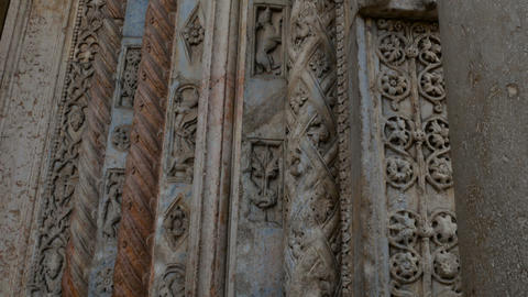 Cathedral of Verona, external Romanesque architecture with bestiaries carved in Footage