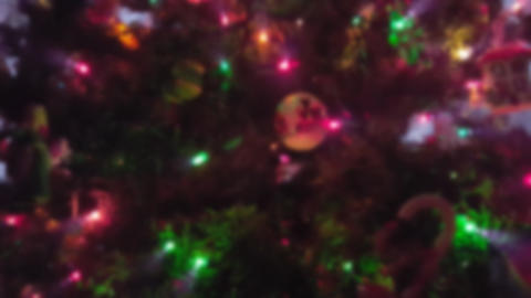 Christmas Tree With Twinkling Lights and Ornaments Up-Close With Blur Effect Footage