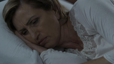 Woman suffering from insomnia because of stress, female health, menopause Footage