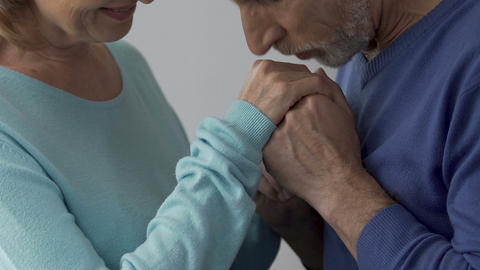 Spouse kissing hands of his beloved wife saying words of love, embarrassment Footage