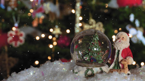 Christmas snow globe ball before blurred background with space for text Live Action