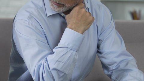 Offended man sitting at office, reluctant to retire from work, aging issues Live Action