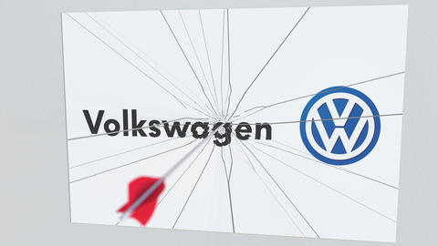 VOLKSWAGEN company logo being cracked by archery arrow. Corporate problems Live Action