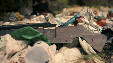 Toxic garbage lying on the ground, problems of recycling, environmental concerns Live Action