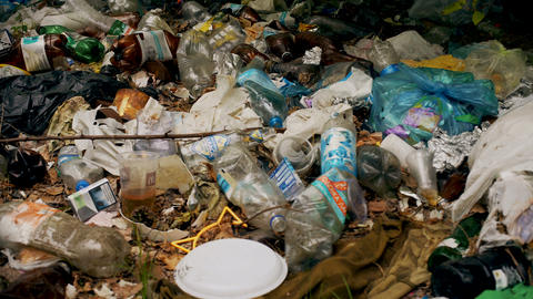 Pile of toxic plastic garbage, consumerism influence on nature, waste management Live Action