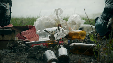 Pile of waste plastic and glass left after picnic, massive consumption problems Live Action