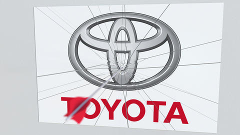 Archery arrow hits plate with TOYOTA logo. Corporate problems conceptual Live Action