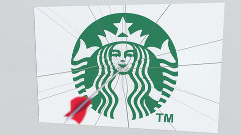 Archery arrow hits plate with STARBUCKS logo. Corporate problems conceptual Live Action