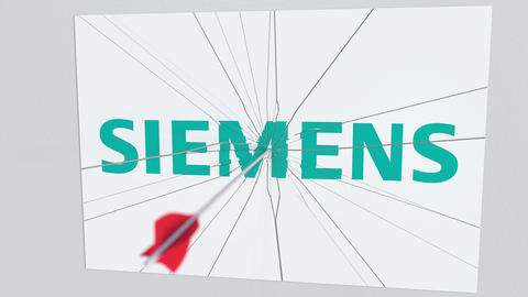 SIEMENS company logo being hit by archery arrow. Business crisis conceptual Footage
