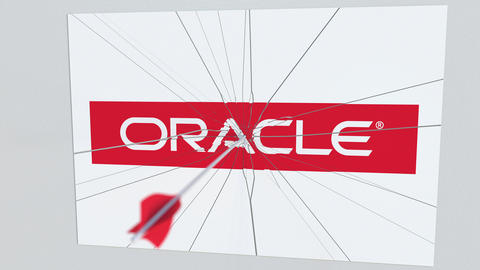 ORACLE company logo being hit by archery arrow. Business crisis conceptual Footage